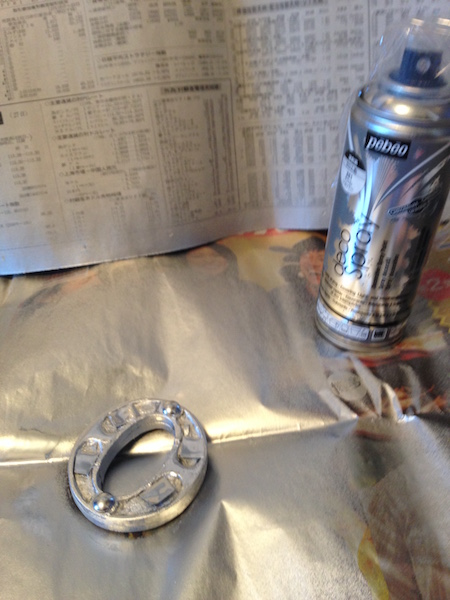Metallic chrome spray paint.