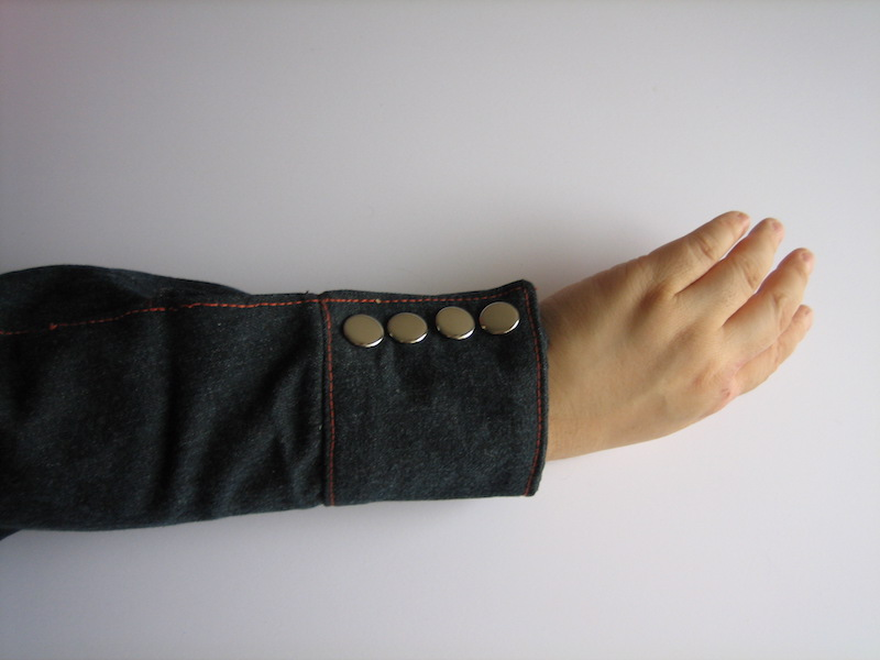 Jean jacket sleeve. Touch the snaps!
